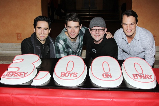 Jersey Boys with their show's celebratory cake